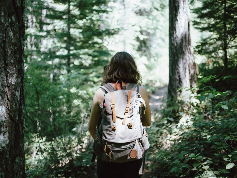 Why Cultivating a Growth Mindset will Transform Your Life | woman hiking in woods | Photo by Jake Melara on Unsplash