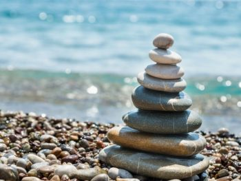 Rock cairn stacked on beach