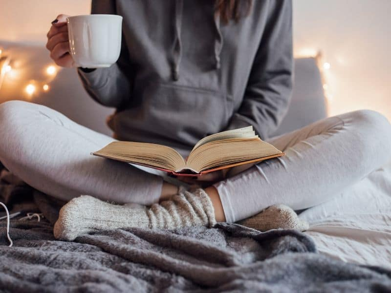 reading and drinking tea in bed