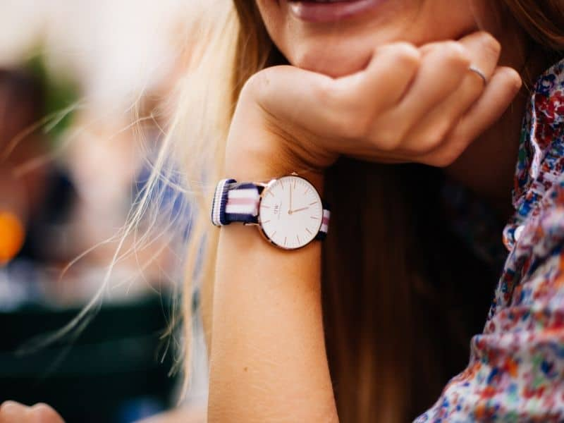 woman with watch smiling