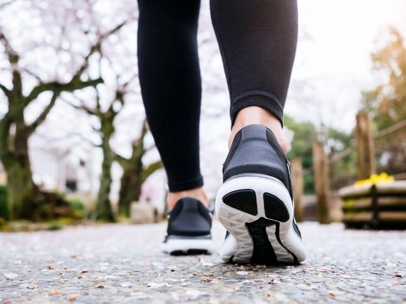 woman legs in exercise clothes walking