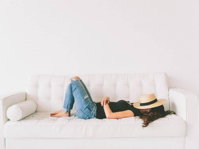 woman lying on sofa relaxing