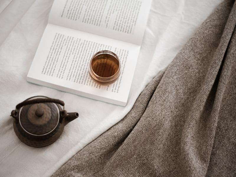 teapot, tea and open book