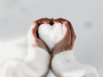 hands holding a heart made from snow - kindness quotes
