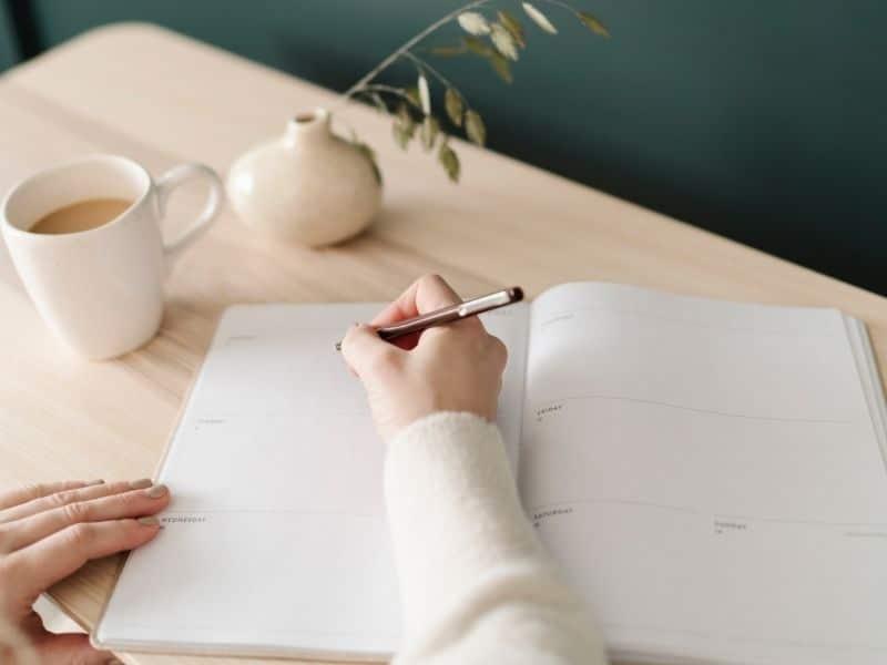 women writing in planner