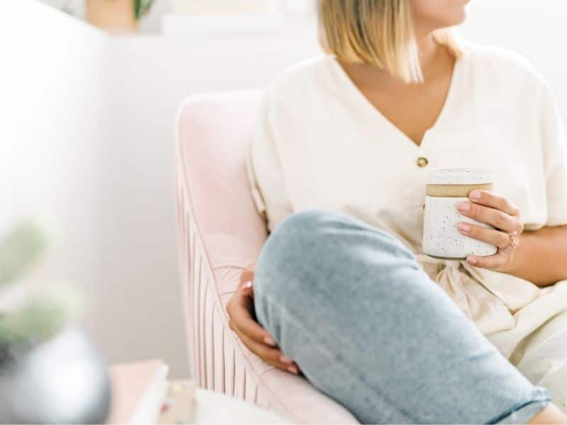 woman sitting with warm drink