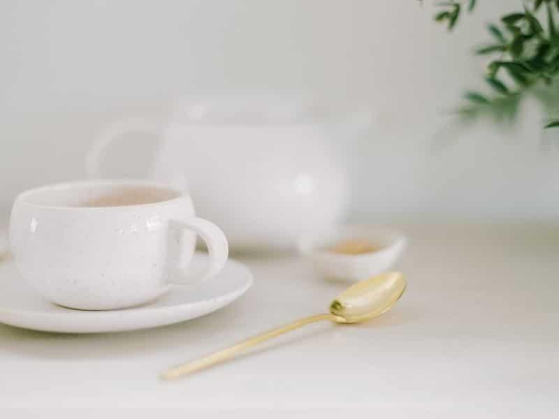 tea cup, tea pot and spoon