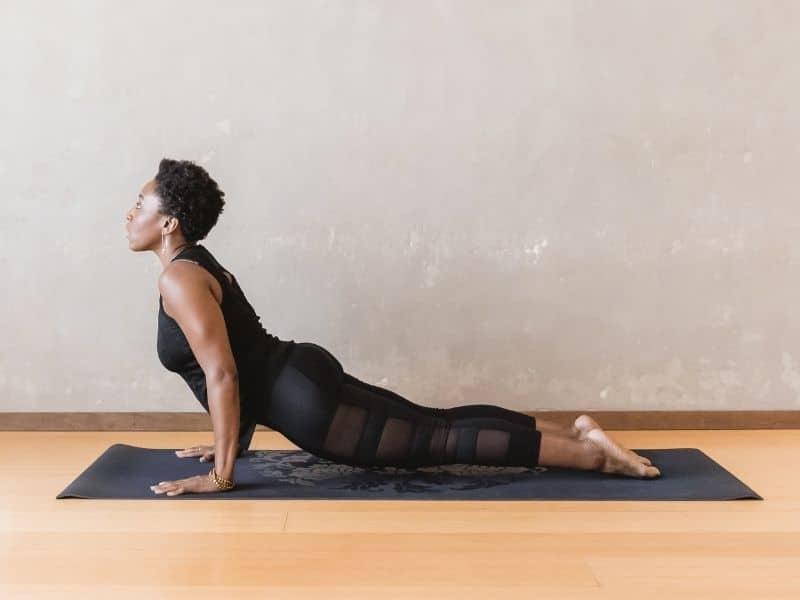 woman doing cobra yoga pose