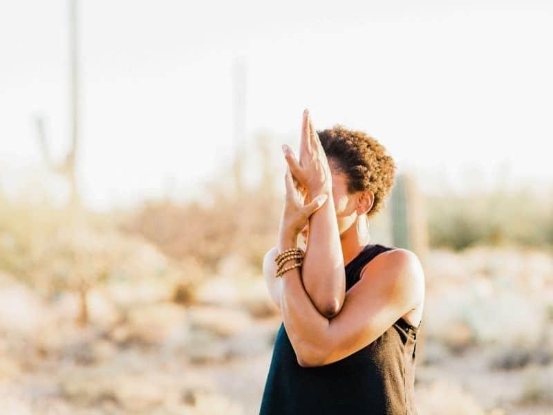 holistic time management woman doing yoga